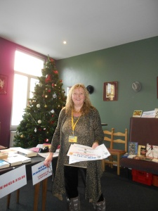 Karen setting up for Bookswap - plenty of multilingual signs to help members find the different book categories & languages..
